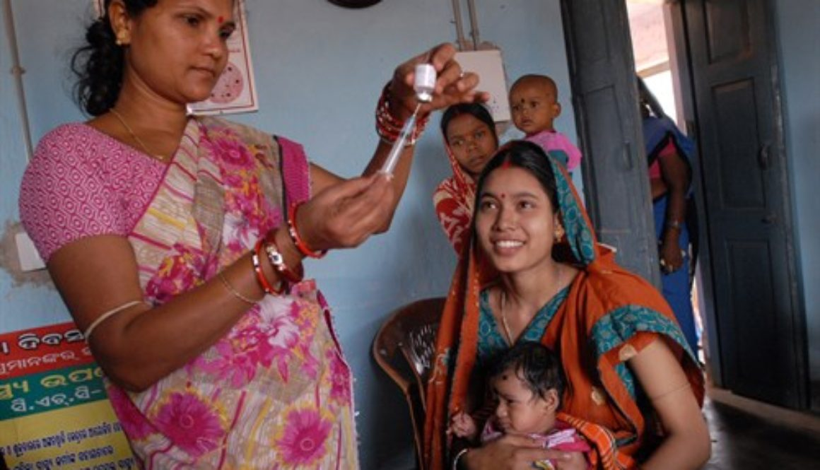 Photo: Pippa Ranger, Innovation Advisor, DFID. Community health worker, Rebati, gives babies like Adilya, polio and other life saving vaccinations for at least the first year of their lives. Britain is working with the Government of Odisha, one of India's poorest states, and UNICEF, to save the lives of thousands of mums and babies.